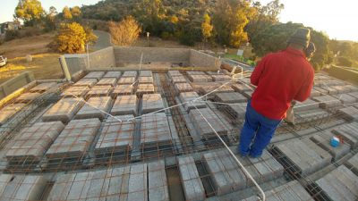 image showing rib & block slab and worker with red jacket